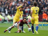 Mark Noble, Jorginho and Marcos Alonso in action during the Premier League game between West Ham United and Chelsea on September 23, 2018