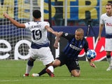 Mousa Dembele and Radja Nainggolan in action during the Champions League group game between Inter Milan and Tottenham Hotspur on September 18, 2018