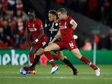 Neymar goes up against Sadio Mane and Jordan Henderson during the Champions League group game between Liverpool and Paris Saint-Germain on September 18, 2018