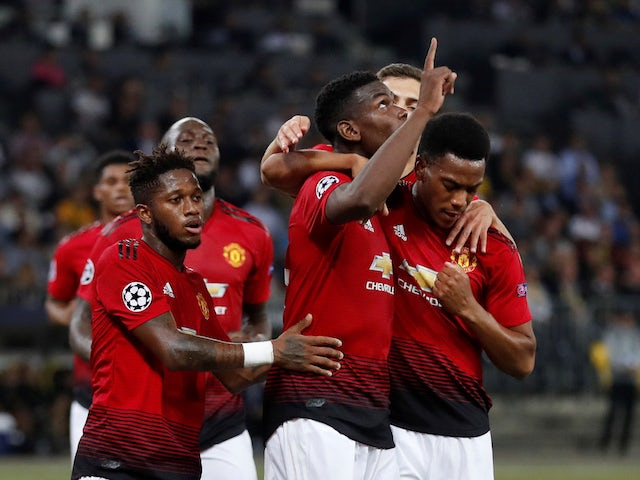 Manchester United midfielder Paul Pogba celebrates with teammate after scoring in his side's Champions League clash with Young Boys on September 19, 2018