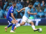 Sergio Aguero and Joe Ralls in action during the Premier League game between Cardiff City and Manchester City on September 22, 2018