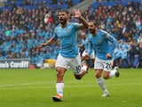Sergio Aguero celebrates scoring during the Premier League game between Cardiff City and Manchester City on September 22, 2018