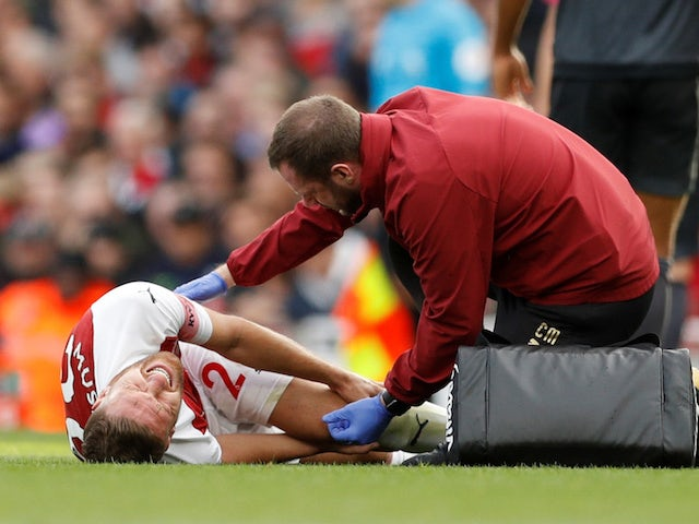 Shkodran Mustafi goes down injured during the Premier League game between Arsenal and Everton on September 23, 2018
