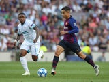 Steven Bergwijn and Philippe Coutinho in action during the Champions League group game between Barcelona and PSV Eindhoven on September 18, 2018