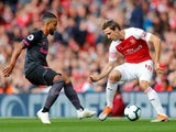 Theo Walcott and Nacho Monreal face off during the Premier League game between Arsenal and Everton on September 23, 2018