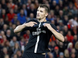 Thomas Meunier celebrates pulling one back during the Champions League group game between Liverpool and Paris Saint-Germain on September 18, 2018