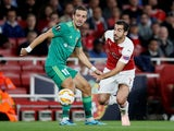 Vyacheslav Sharpar and Henrikh Mkhitaryan in action during the Europa League group game between Arsenal and Vorskla Poltava on September 20, 2018