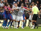 Paul Dummett separates Wilfried Zaha and Kenedy during the Premier League game between Crystal Palace and Newcastle United on September 22, 2018