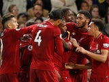 Daniel Sturridge is mobbed by his Liverpool teammates after equalising in the Premier League meeting with Chelsea on September 29, 2018