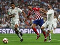 Raphael Varane and Dani Carvajal hold off Diego Costa in the Madrid derby between Real Madrid and Atletico Madrid on September 29, 2018