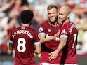 West Ham goalscorers Felipe Anderson, Andriy Yarmolenko and Marko Arnautovic celebrate during their Premier League clash with Manchester United on September 29, 2018
