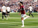 West Ham's Felipe Anderson wheels away in celebration after opening the scoring during his side's Premier League clash with Manchester United on September 29, 2018