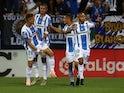 Leganes players celebrate after scoring against Barcelona on September 26, 2018