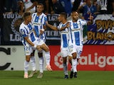 Leganes players celebrate after scoring against Barcelona on September 26, 2018