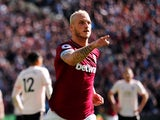 West Ham's Marko Arnautovic wheels away in celebration after scoring during his side's Premier League clash with Manchester United on September 29, 2018