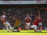 Arsenal's Nacho Monreal and Shkodran Mustafi challenge Troy Deeney of Watford during their Premier League clash on September 29, 2018