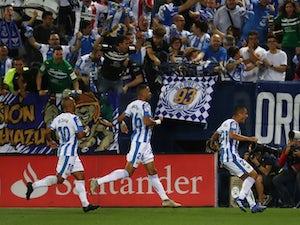 Oscar Rodriguez celebrates scoring for Leganes in their match against Barcelona on September 26, 2018