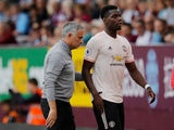 Paul Pogba and Jose Mourinho pictured during Manchester United's game with Burnley on September 2, 2018