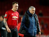 Phil Jones and Jose Mourinho after the EFL Cup third-round game between Manchester United and Derby County on September 25, 2018