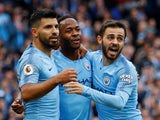Raheem Sterling celebrates with Sergio Aguero and Bernardo Silva after opening the scoring for Manchester City against Brighton & Hove Albion on September 29, 2018