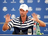 Webb Simpson gets hands-on during a Ryder Cup presser on September 26, 2018