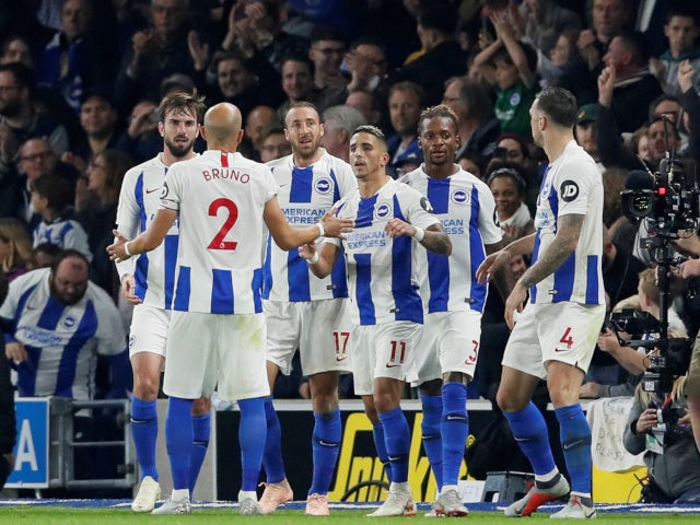 Glenn Murray celebrates with his teammates after opening the scoring for Brighton & Hove Albion against West Ham United on October 5, 2018