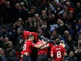 Manchester United players celebrate after scoring the winner against Newcastle United on October 6, 2018