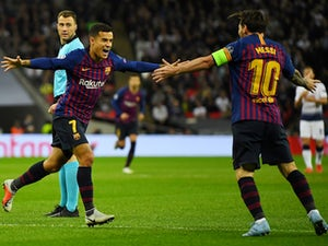 Barcelona midfielder Philippe Coutinho celebrates with Lionel Messi after scoring the opening goal in his side's Champions League clash with Tottenham Hotspur on October 3, 2018