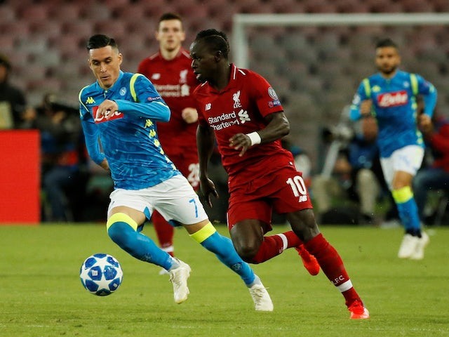 Liverpool winger Sadio Mane is chased by Napoli's Jose Callejon during their Champions League clash on October 3, 2018