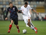 Marcus Rashford and Mateo Kovacic battle for the ball during England's goalless draw with Croatia on October 12, 2018