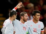 Spain captain Sergio Ramos celebrates with Rodri and Alvaro Morata after scoring during his side's international friendly with Wales on October 11, 2018