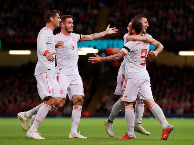 Spain players celebrate Paco Alcacer's opener against Wales on October 11, 2018