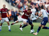 West Ham United's Mark Noble and Tottenham Hotspur's Lucas Moura battle for the ball at the London Stadium on October 20, 2018