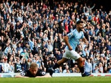 Sergio Aguero wheels away after opening the scoring for Manchester City in their Premier League meeting with Burnley on October 20, 2018