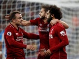 Mohamed Salah celebrates with Adam Lallana and Xherdan Shaqiri after opening the scoring in Liverpool's Premier League clash with Huddersfield on October 20, 2018