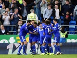 Kadeem Harris celebrates with his Cardiff City teammates after rounding off the scoring in his side's 4-2 Premier League win over Fulham on October 20, 2018