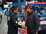 David Wagner and Jurgen Klopp shake hands ahead of the Premier League clash between Huddersfield Town and Liverpool on October 20, 2018