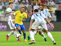 Brazil forward Neymar carries the ball while surrounded by Argentina players during the international friendly between the two sides on October 16, 2018
