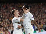 Raheem Sterling celebrates with Kieran Trippier after scoring the opener during the Nations League game between Spain and England on October 15, 2018