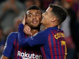 Rafinha celebrates with Philippe Coutinho after opening the scoring for Barcelona in their Champions League tie with Inter Milan on October 24, 2018