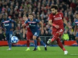 Mohamed Salah scores from the spot during the Champions League game between Liverpool and Red Star on October 24, 2018