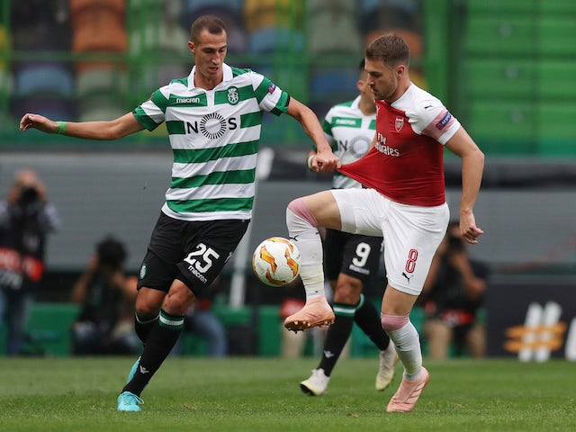 Radosav Petrovic and Aaron Ramsey in action during the Europa League group game between Sporting Lisbon and Arsenal on October 25, 2018