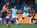 Raheem Sterling and Mykola Matviyenko in action during the Champions League group game between Shakhtar Donetsk and Manchester City on October 23, 2018