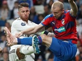 Sergio Ramos and Michael Krmencik in action during the Champions League group game between Real Madrid and Viktoria Plzen on October 23, 2018