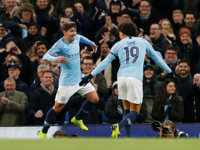 Brahim Diaz celebrates with Leroy Sane after putting Manchester City two goals ahead against Fulham on November 1, 2018