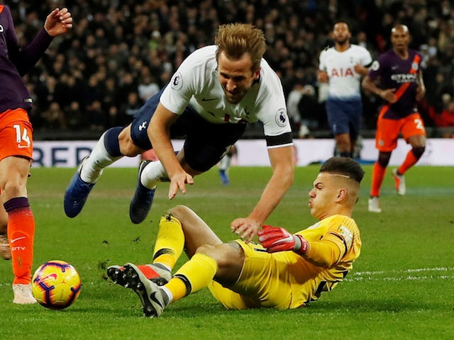 Harry Kane and Ederson in action during the Premier League game between Tottenham Hotspur and Manchester City on October 29, 2018