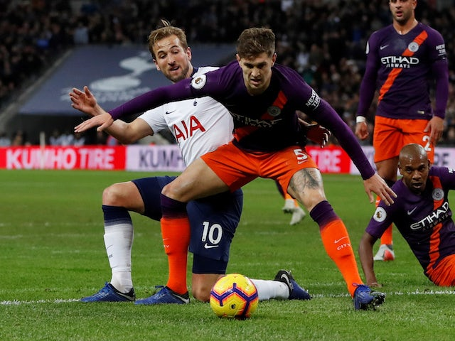 John Stones and Harry Kane in action during the Premier League game between Tottenham Hotspur and Manchester City on October 29, 2018