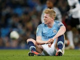 Kevin De Bruyne is left floored following a tussle with Timothy Fosu-Mensah in Manchester City's EFL Cup tie with Fulham on November 1, 2018