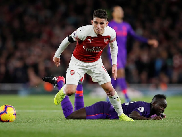 Lucas Torreira and Sadio Mane in action during the Premier League game between Arsenal and Liverpool on November 3, 2018