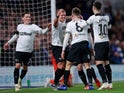 Derby County's Martyn Waghorn celebrates with teammates after scoring for his side against Chelsea on October 31, 2018